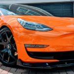 Orange wrapped Tesla Model 3.