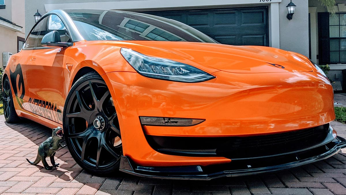 Orange wrapped Tesla Model 3.