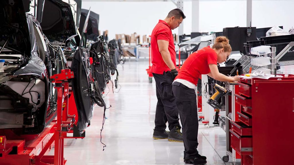 Workers at the Tesla Fremont car factory.