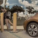 Nissan Leaf owner unplugs Tesla Model 3 to charge her own car.