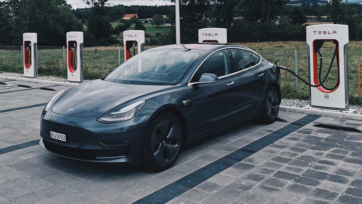 Tesla Model 3 at a Supercharger Station.
