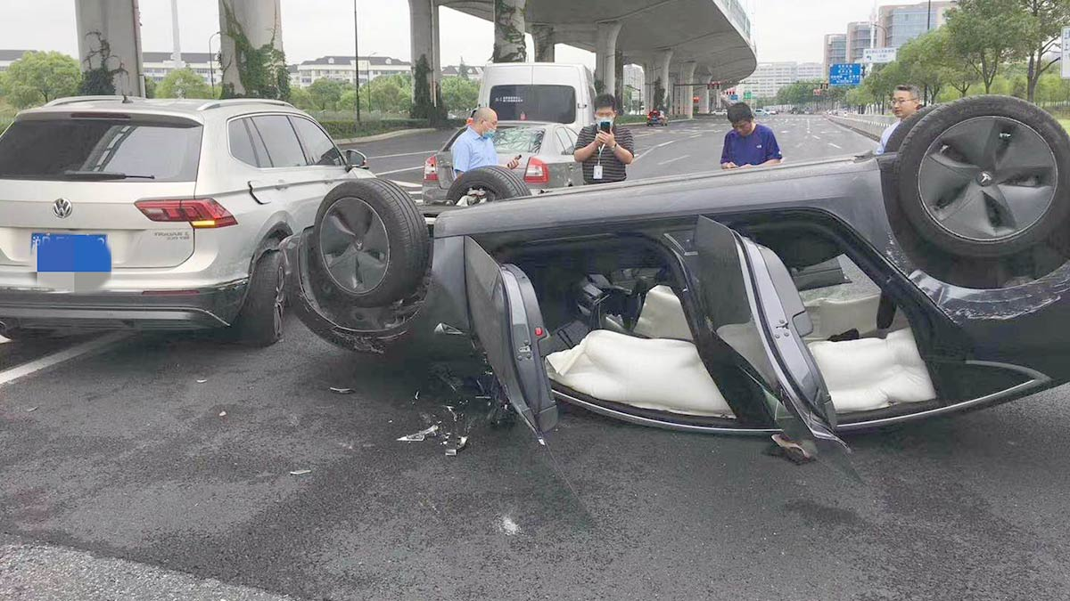 Tesla Model 3 resting on its roof after the rollover accident in Shanghai China.
