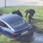 Tesla Model 3 fell into the river canal.