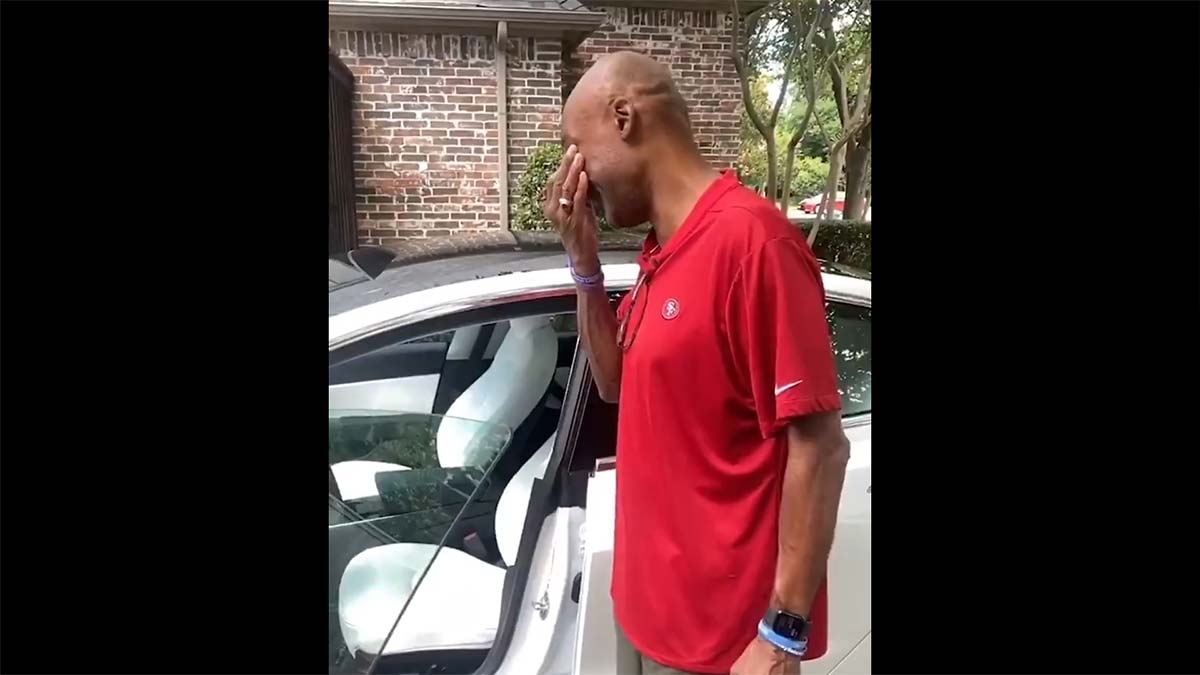 Past NBA player Vince Carter receives his Father's Day gift, a white Tesla Model 3 from his son Solomon Thomas who is a NFL player.