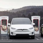 Left to right: Tesla Model 3, Model X, and Model Y electric vehicles.