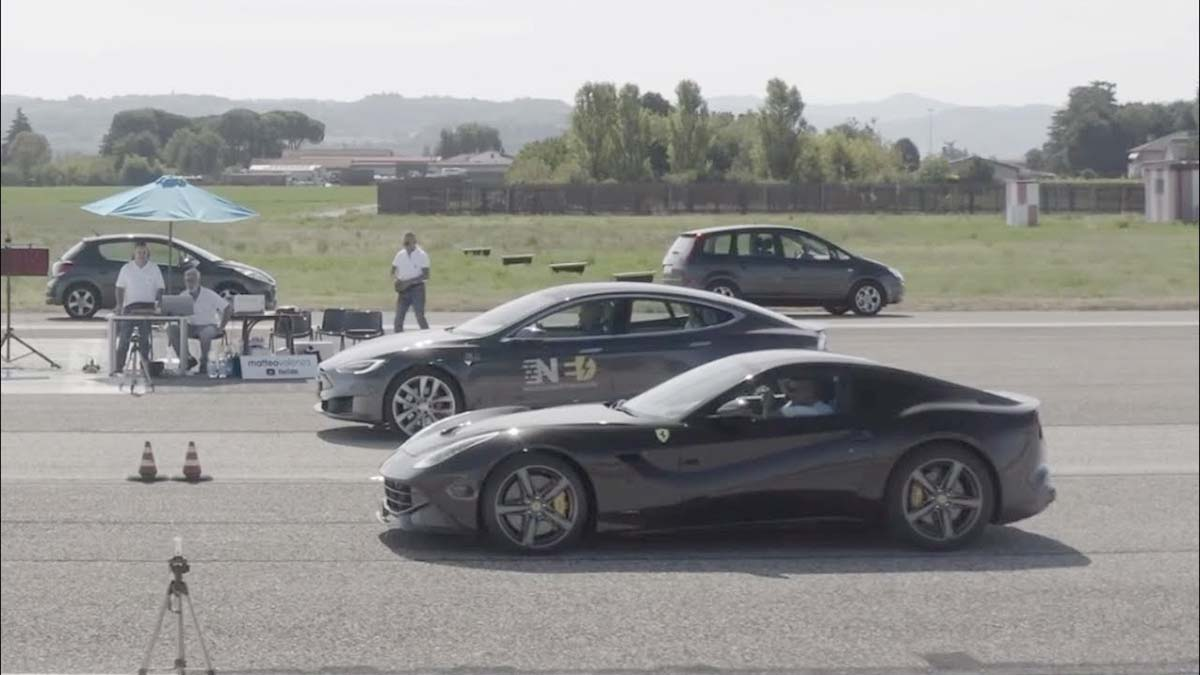 Tesla Model S P100D and Ferrari F12 getting ready for the 1/4-mile drag race.