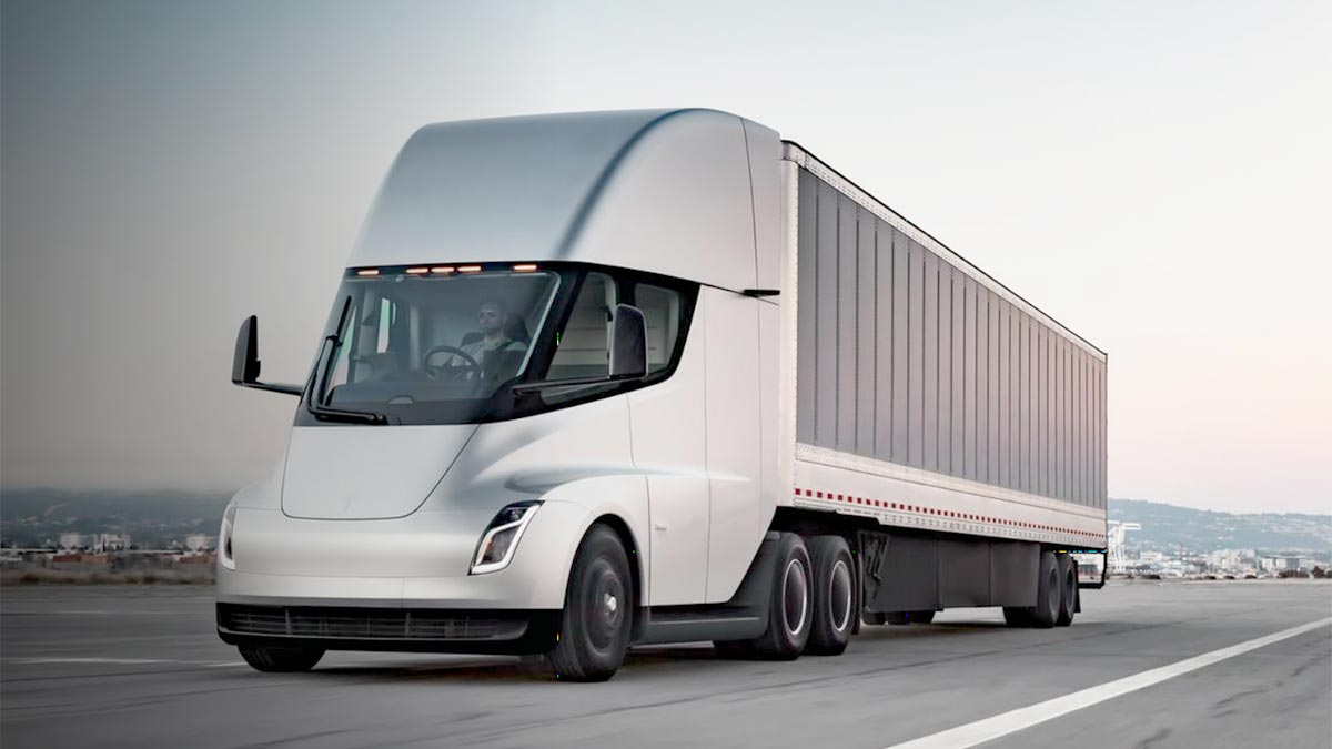 Tesla Semi Truck prototype in silver color, accelerating on the highway.