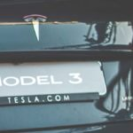 Tesla Model 3 rear license plate with Tesla.com written underneath.