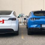 Tesla Model Y side-by-side with the Ford Mach-E prototype, both cars charging.