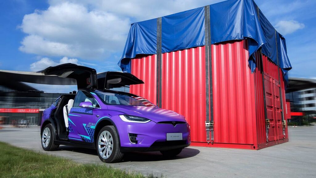 Tesla Model X wrapped in Game For Peace 'Awesome Purple' skin.