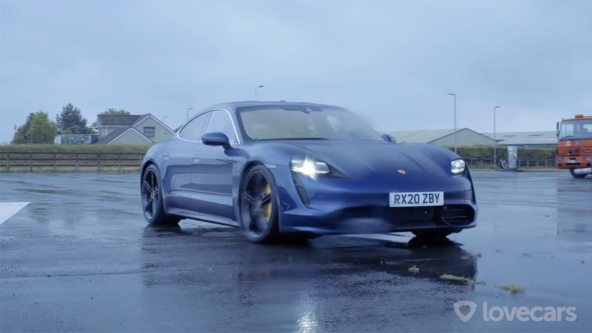 Blue Porsche Taycan Turbo  front view with DRLs.