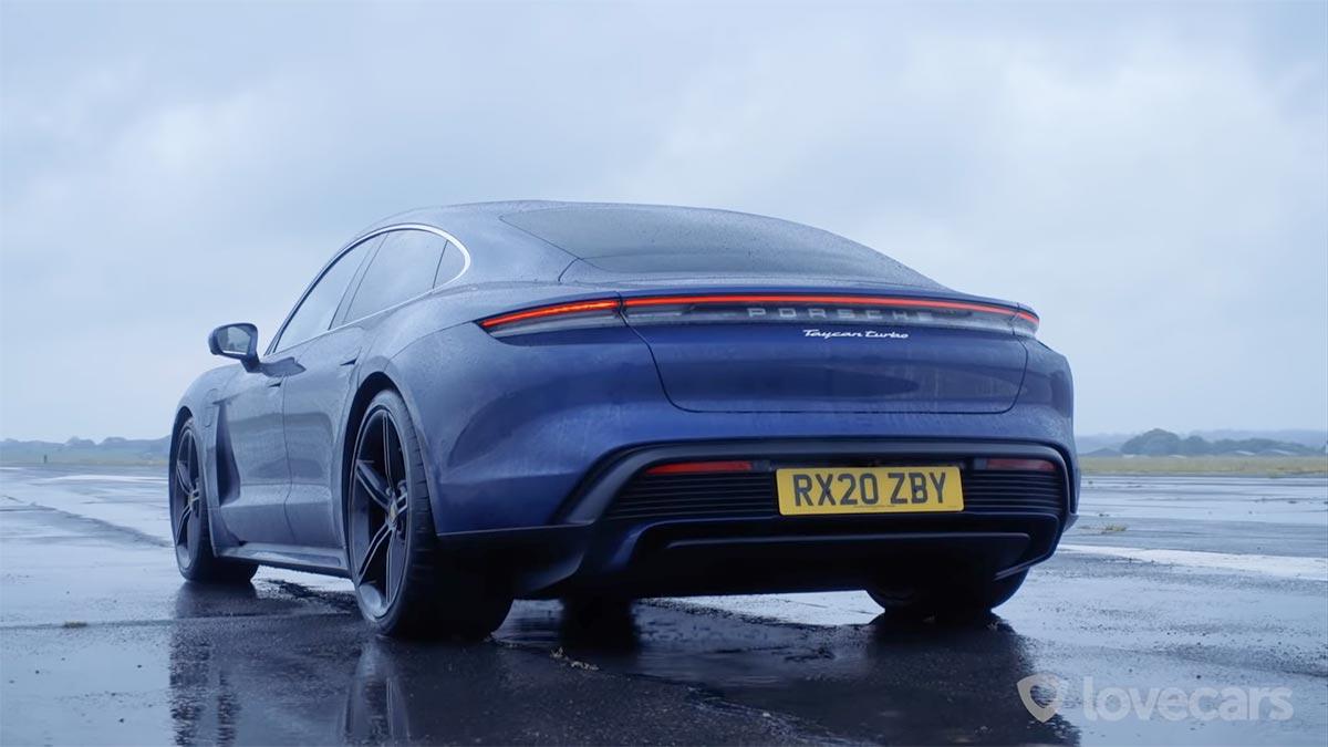 Blue Porsche Taycan Turbo rear view.