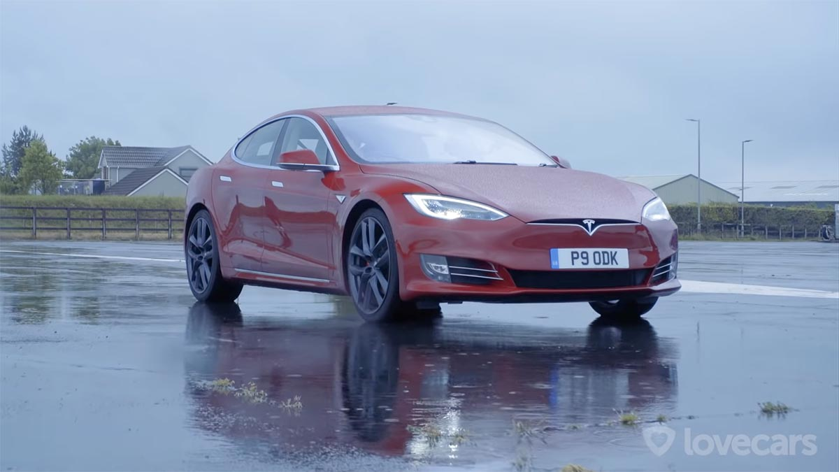 Red Tesla Model S P90D - front view with DRLs.