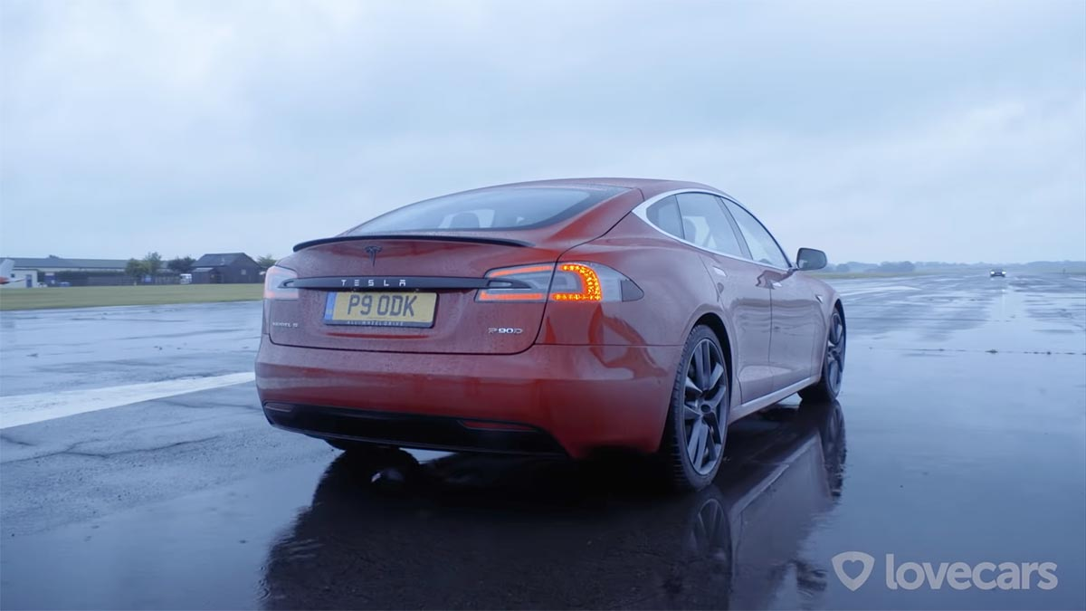 Red Tesla Model S P90D - rear view.