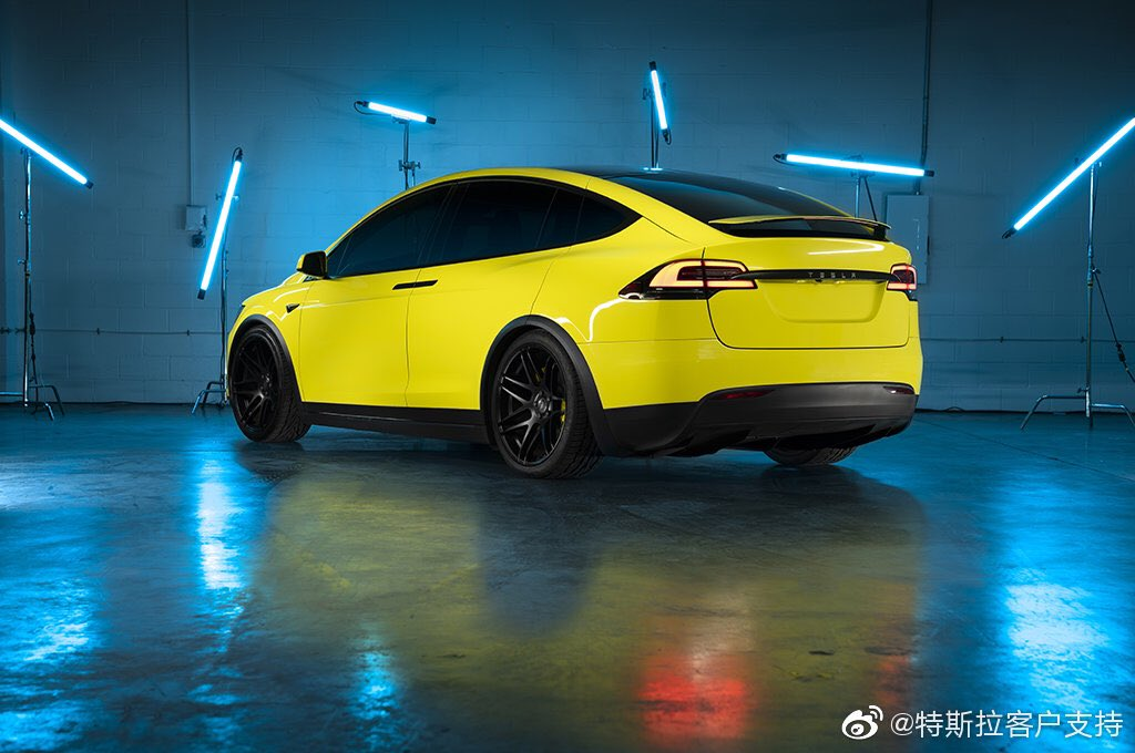 Yellow wrapped Tesla Model X posted by Tesla China on Weibo after starting the official Tesla wrap service (rear view).