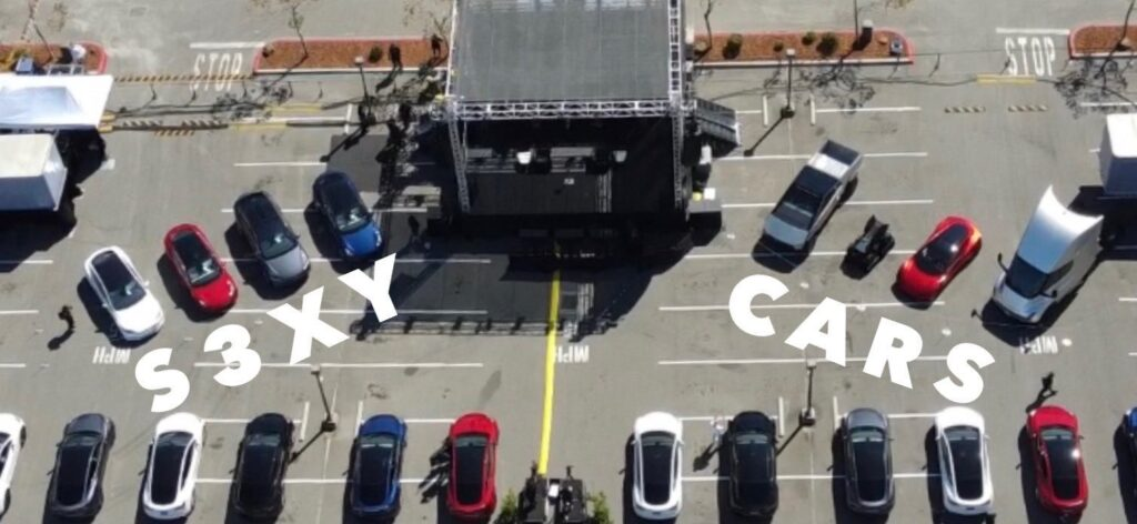 Aerial view of the stage, prototype vehicles, and the front row Tesla Model Y SUVs on Battery Day.