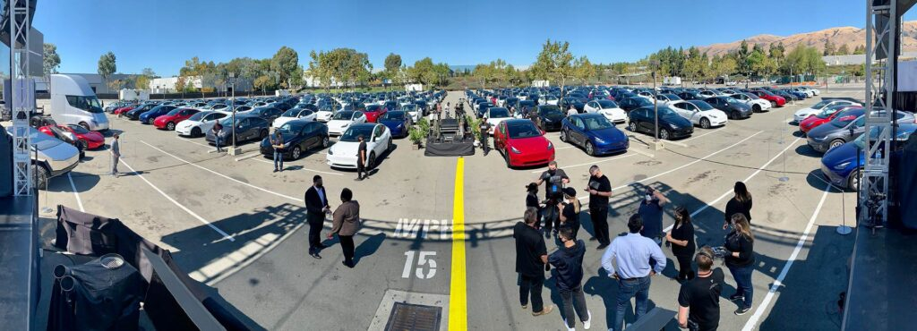 Formation of Tesla guest cars on Battery Day at the Fremont factory drive-in. A view from the presentation stage.