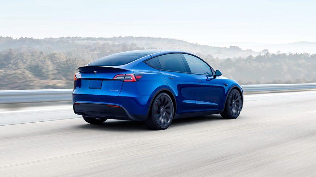 Tesla Model Y in Metallic Blue color (rear view).