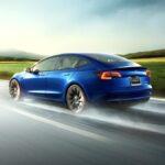 2021 Tesla Model 3 in blue, rear view.