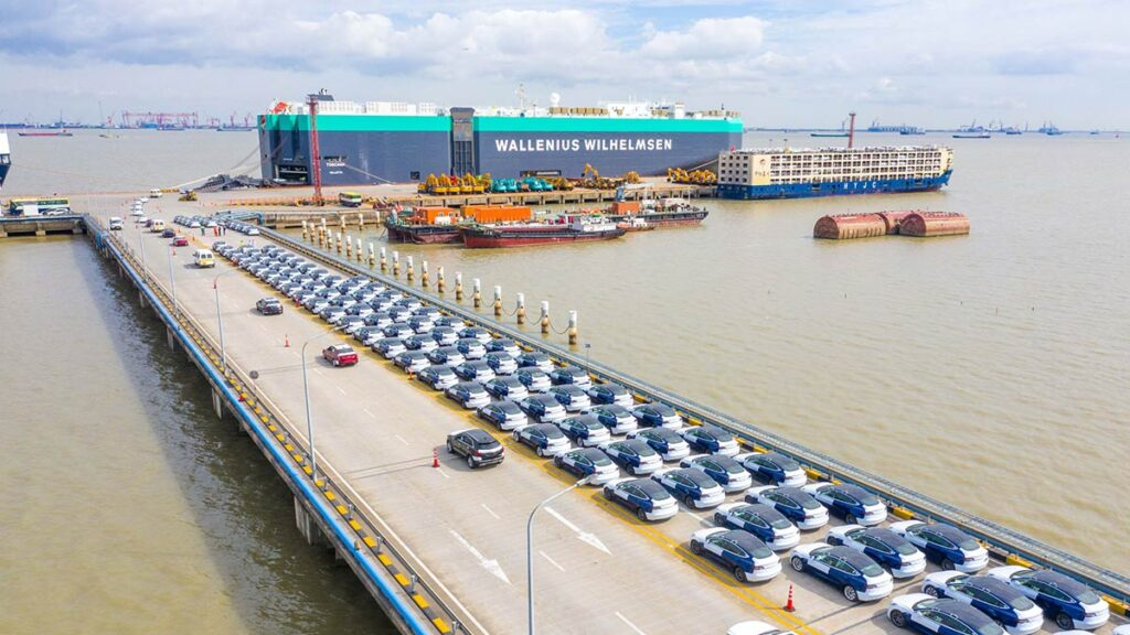 A fleet of Made-in-China Tesla Model 3 cars at the Port of Shanghai waiting to be loaded on the vehicle transport vessel named Toscana by Wallenius Wilhemsen.