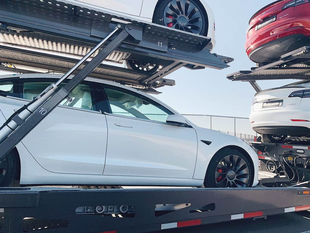 Car carrier trailer loaded with 2021 Tesla Model 3 Performance (European Spec).