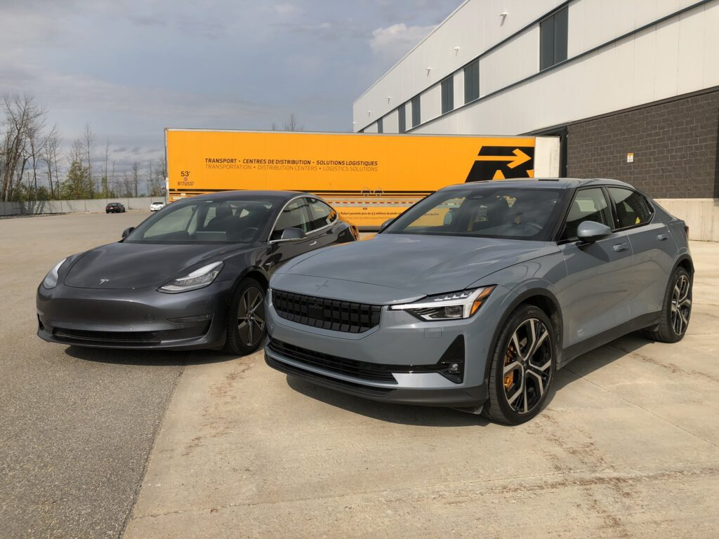 Tesla Model 3 and Polestar 2 side-by-side (front view).