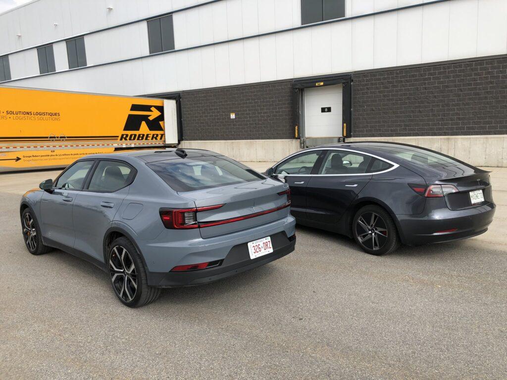 Tesla Model 3 and Polestar 2 side-by-side (rear view).