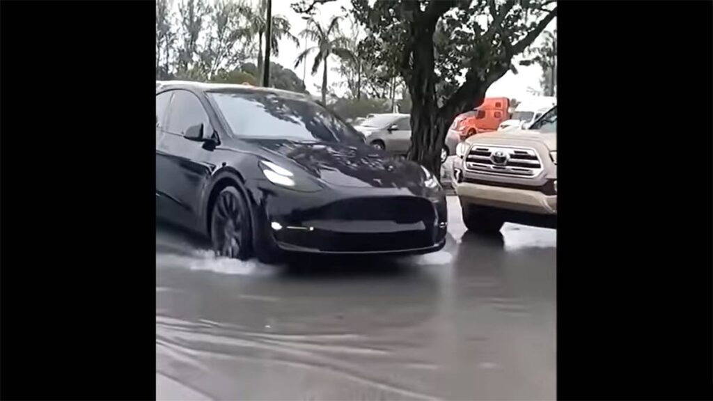 Tesla Model Y reaches to owner on its own through floodwater using the Smart Summon feature.