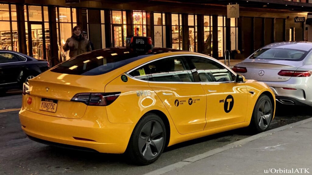 Tesla Model 3 yellow cab on the streets of NYC.