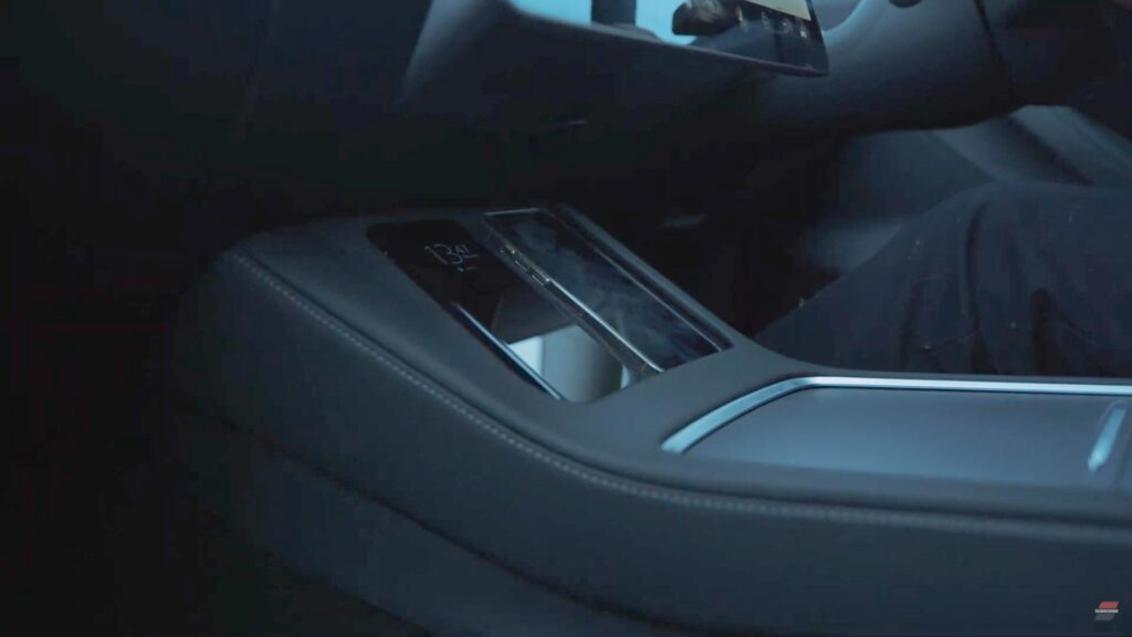 Two wireless phone charging docks in the 2021 Tesla Model 3.