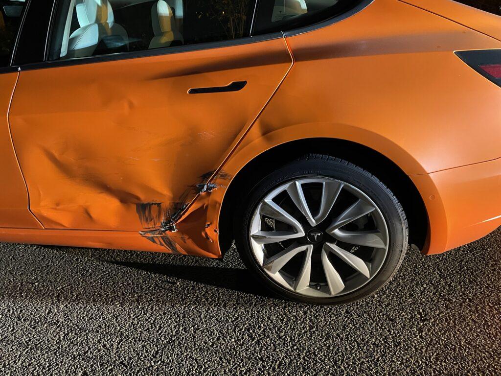The orange Tesla Model 3 after the highway accident.