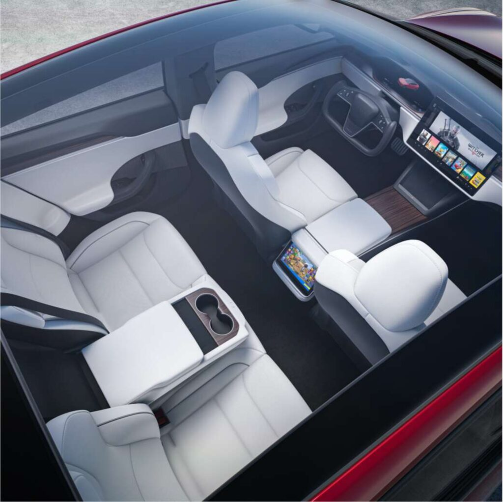 Aerial shot of the design refresh 2021 Tesla Model S showing the car's interior and all three screens.