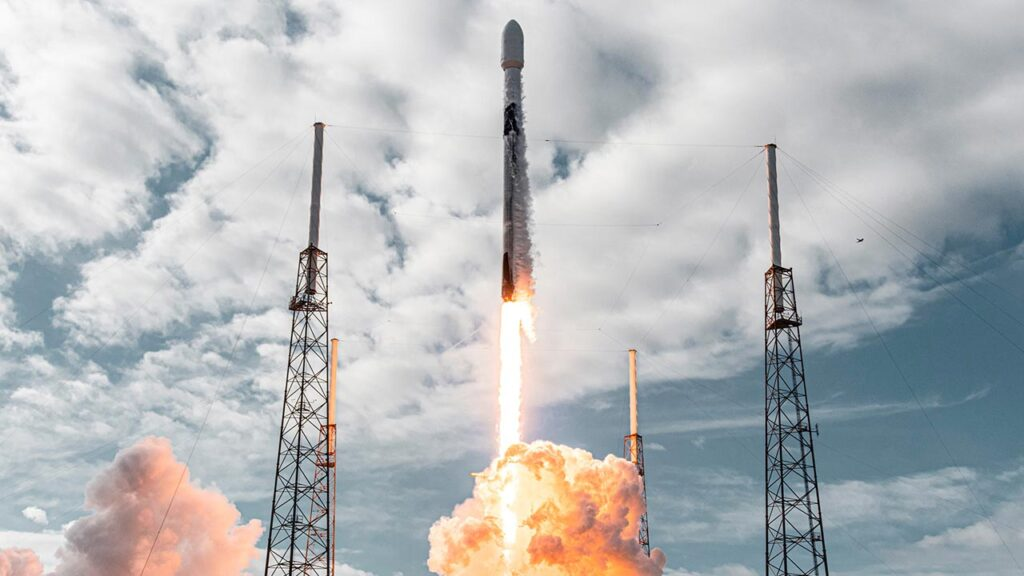 SpaceX Falcon 9 firing from the launch pad carrying a record 143 satellites.