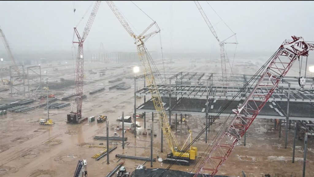 Under construction Tesla Gigafactory Texas on a snowy day (drone video).