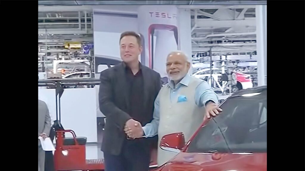 Tesla CEO Elon Musk shaking hands with Indian PM Narendra Modi on his visit to the Tesla factory in 2015.