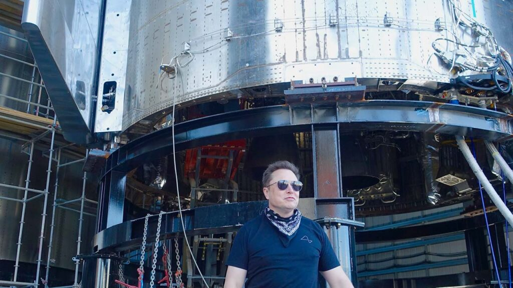 Elon Musk posing in front of Starship Prototype #SN9.