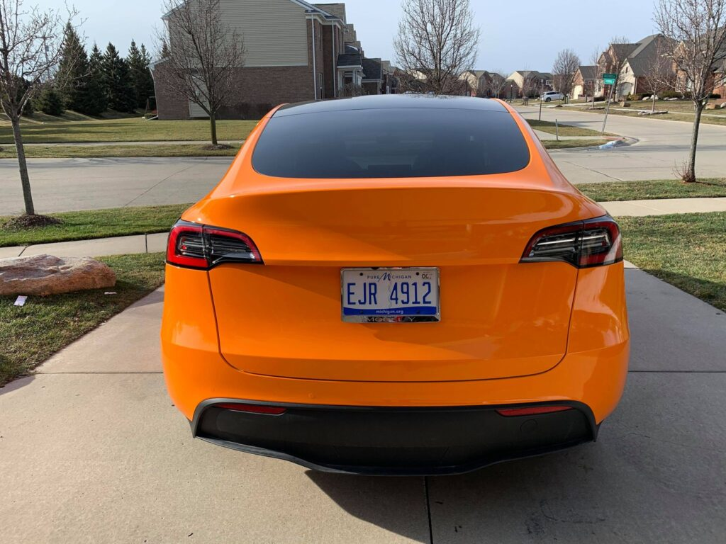 Orange wrapped Tesla Model Y rear fascia.