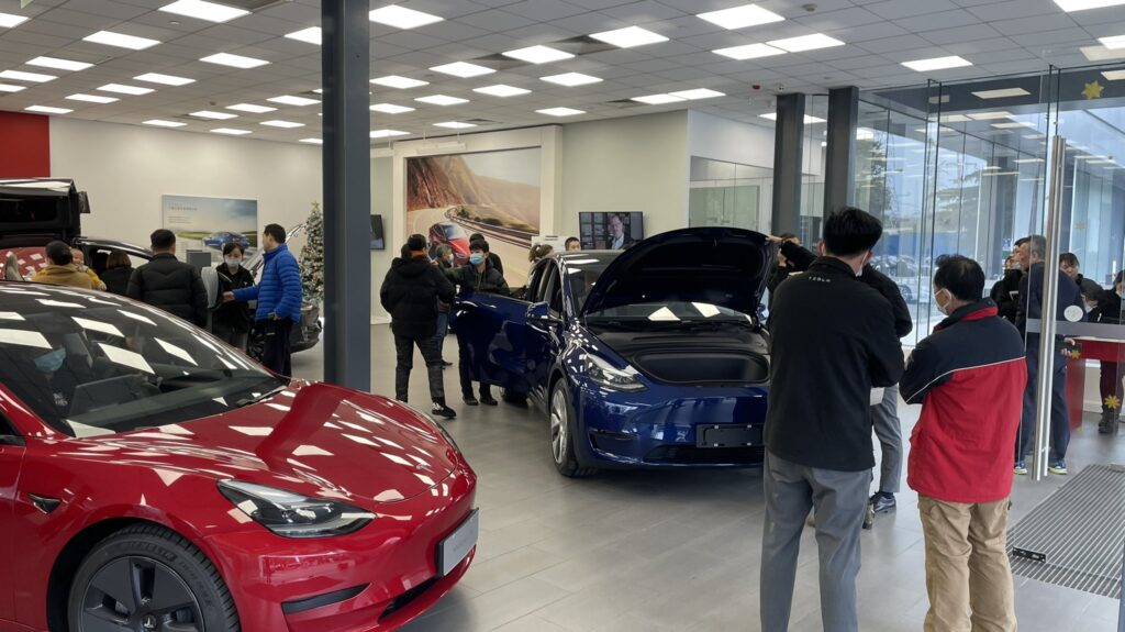 People checking out the Tesla Model Y at the Tesla store/showroom in Shanghai, China.