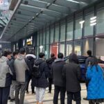 People gather outside a Tesla store in China to get a glimpse of the Model Y.