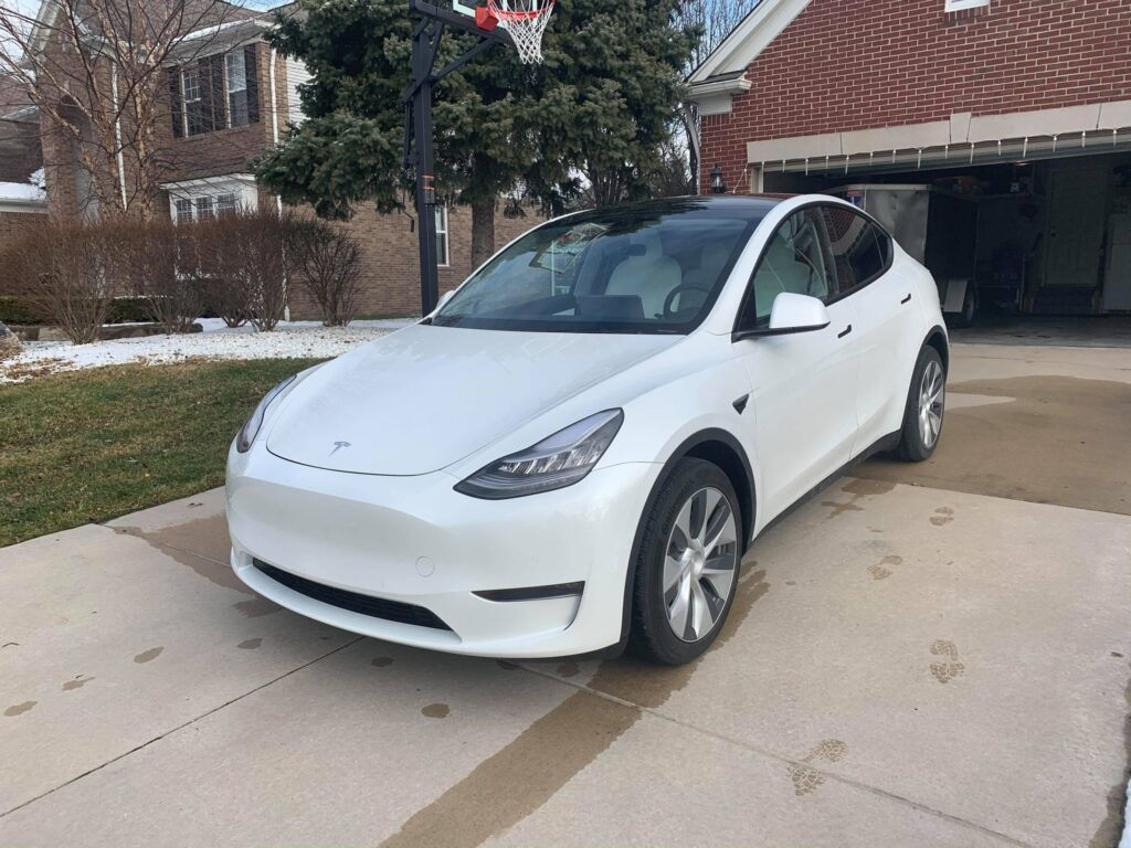 White Tesla Model Y before getting wrapped in the orange color.