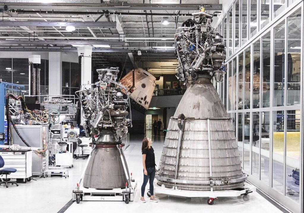 Side by side: Merlin engine, human, and the giant Raptor engine at a SpaceX complex.