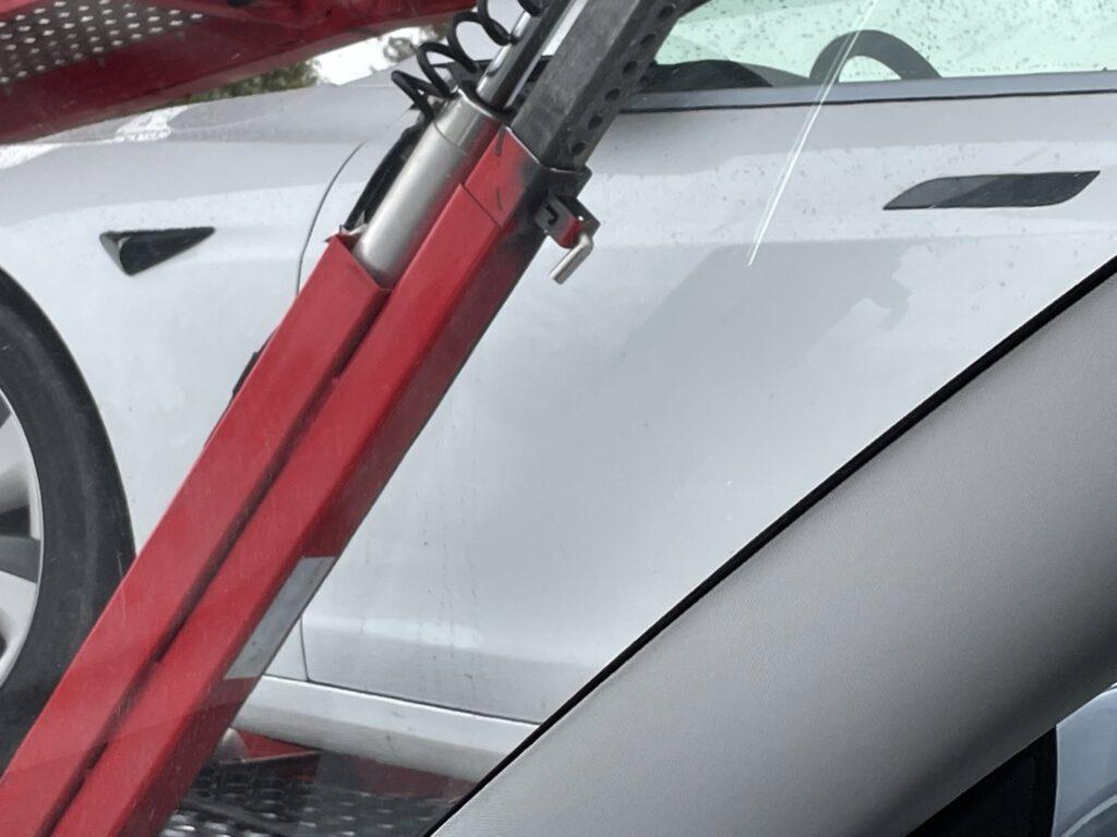 2021 Tesla Model S leaving Fremont factory with regular steering wheel.