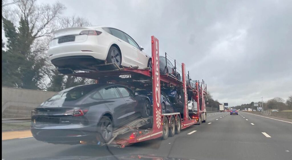 Tesla Model 3 electric cars loaded on a car carrier trailer, spotted in the UK.