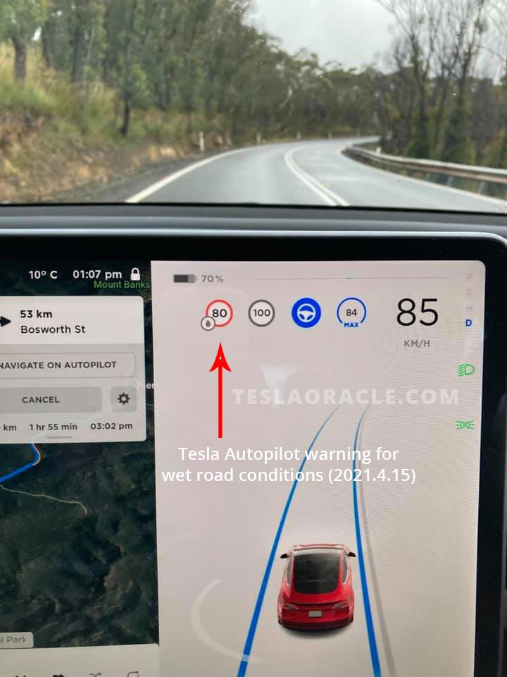 Tesla Autopilot showing wet road conditions speed sign (new in 2021.4.15 software update).