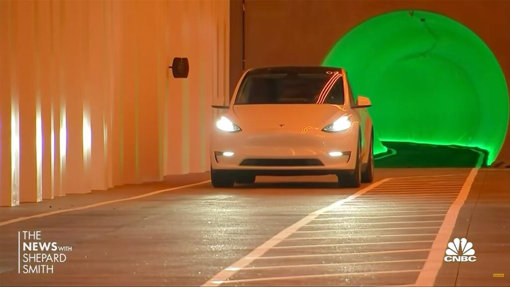 A white Tesla Model 3 inside the Las Vegas Convention Center underground loop.