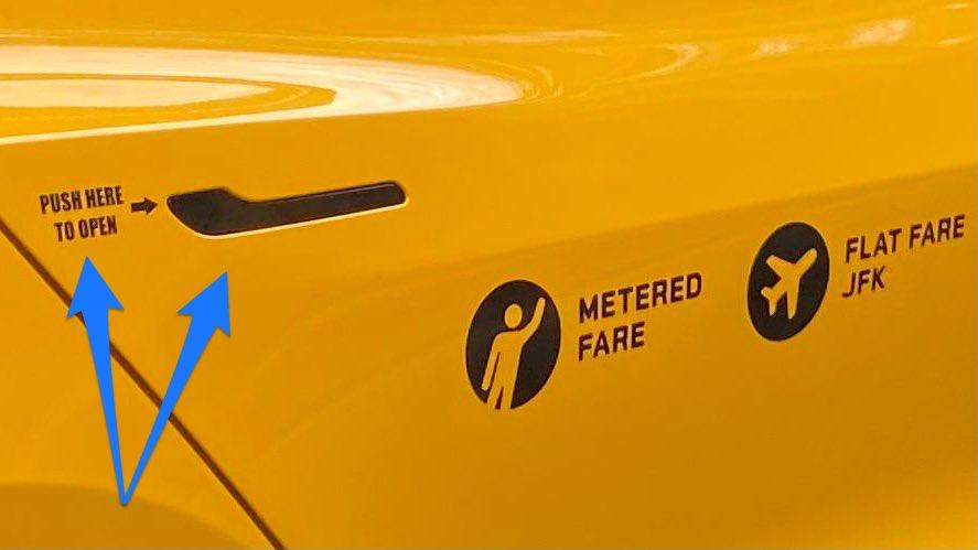 Tesla Model 3 NYC taxicab door handle sticker tells passengers how to open the door.