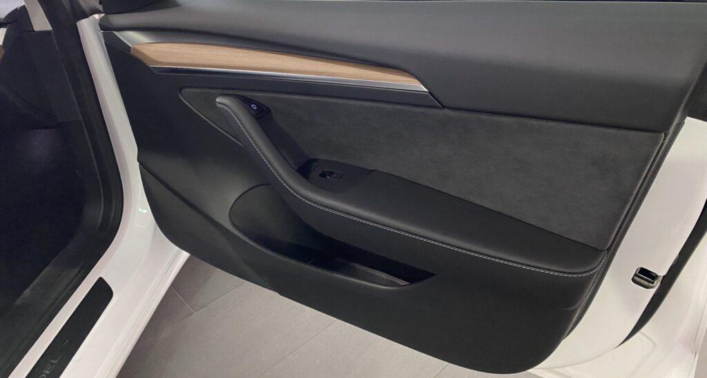 2021 Tesla Model 3 new door panel design with wood trim (door open).