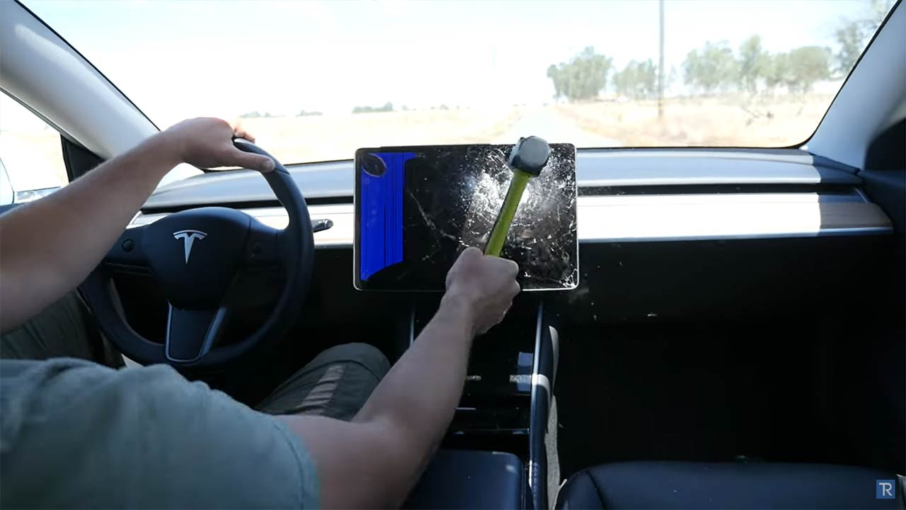 Tesla Model 3 center touchscreen smashes after sustaining hard hits with a hammer.