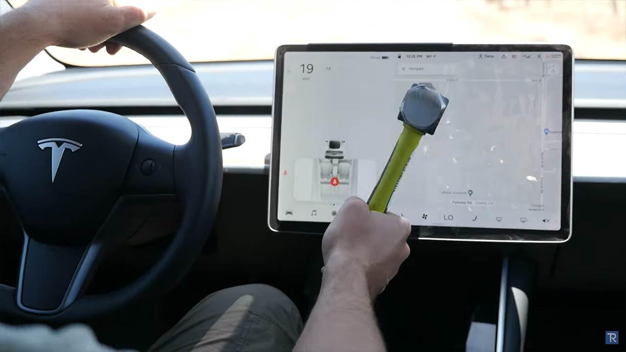 Tesla Model 3 center screen after sustaining light to medium hammer hits.