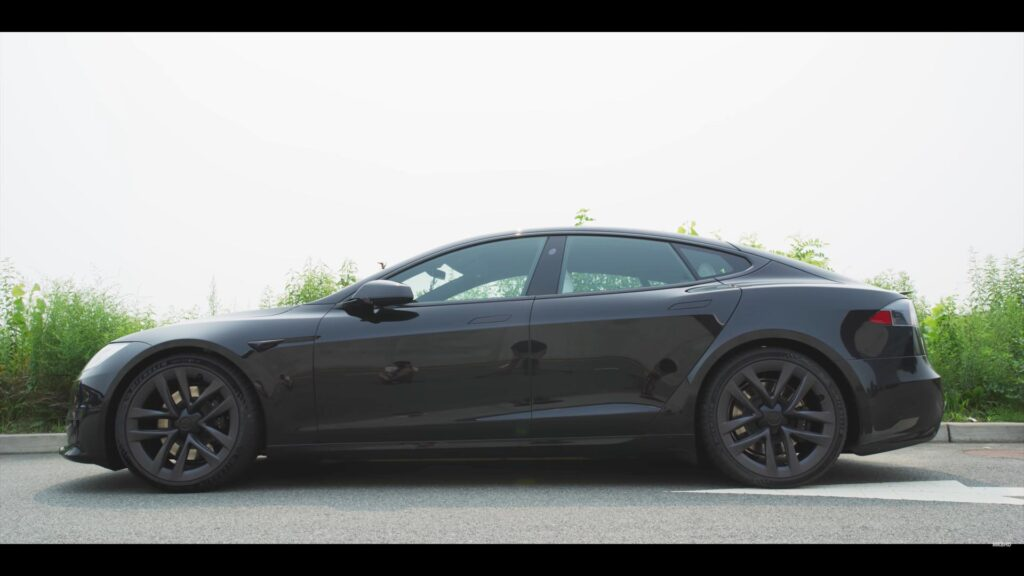 Side profile view of the Tesla Model S Plaid in black color.